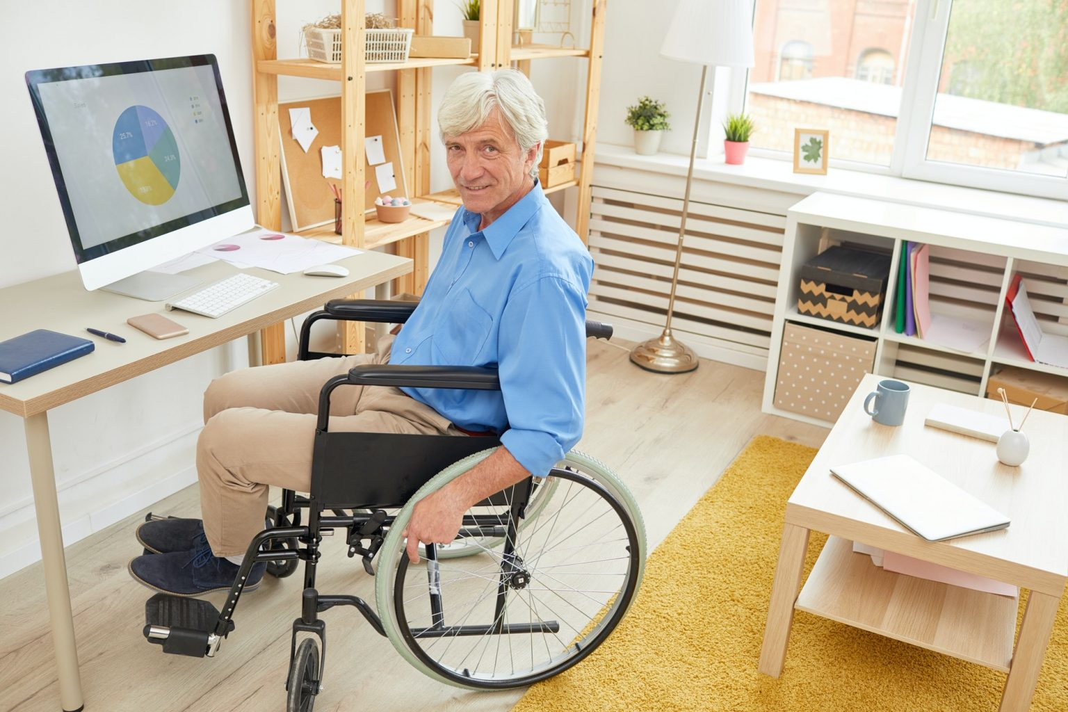 Disabled man working with graphics