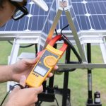 Engineer with energy measurement photovoltaic modules for renewable energy